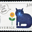 A stamp printed in Sweden shows a cat blows a kiss and a hug — Stock Photo #12429547