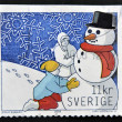 A stamp printed in Sweden shows children are building a snowman — Stock Photo