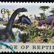 Stock Photo: Stamp printed in USshows Brontosaurus, Stegosaurus & Allosaurus, age of reptiles