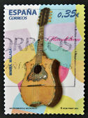 A stamp printed in Spain shows a mandolin — Stock Photo