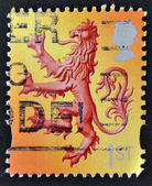 Stamp printed in Great Britain shows image of the Lion Rampant, the banner of the King of Scots — Stock Photo
