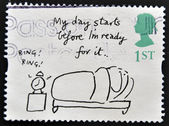 A stamp printed in Great Britain shows 'My day starts before I'm ready for it' (Mel Calman) — Foto Stock