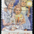 A christmas stamp printed in Australia shows Grandmother and grandaughters with candles — Stock Photo