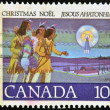 Stamp printed in Canada, shows Hunter Following - Stock Photo