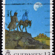 Stamp printed in Guernsey shows arrival in Bethlehem of Mary and Joseph — Stok Fotoğraf #12683244