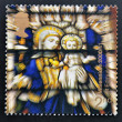A stamp printed in Great Britain shows Virgin and Child Stained Glass Window, St Edmundsbury Cathedral - Foto Stock