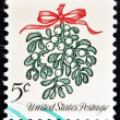 a christmas postage stamp printed in usa shows mistletoe — Stock Photo