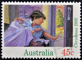 Stamp printed in Australia shows boy jumping from bed Christmas morning — Stock Photo