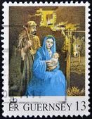A stamp printed in Guernsey shows nativity — Stockfoto