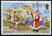 A stamp printed in Jersey shows Santa Claus in Jersey airport — Stock Photo