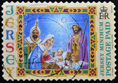A stamp printed in Jersey shows Nativity — Stock Photo