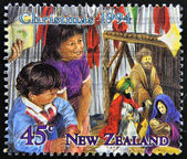 A stamp printed in New Zealand shows children celebrating Christmas — Stock Photo