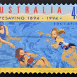 A stamp printed in Australia shows lessons to teach swimming — Photo