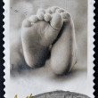 Stamp printed in Australishows Feet of baby — Stock Photo #12755912