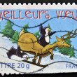 Stamp printed in France shows two penguins, reindeer and sled — Stock Photo