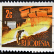 A stamp printed in Rhodesia shows image of a industry - Stock Photo