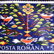 Stamp printed in Romania shows Romanian Peasant Rugs — Stok fotoğraf
