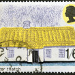 A stamp printed in Great Britain shows British Rural Architecture, ulster thatch — Stock Photo