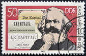 "A stamp printed in German Democratic Republic shows Karl Marx and the book ""Capital"" — Stock Photo"