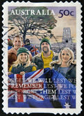 A stamp printed in Australia shows Young with the flag and the slogan Lest We Forget - We Will Remember Them — Stock Photo