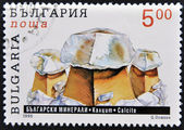 A stamp printed in Bulgaria shows calcite — Stock Photo