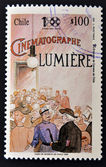 A stamp printed in chile shows poster commemorating the first movie of cinema — Stock Photo