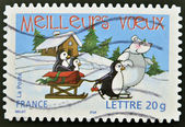 A stamp printed in France shows penguins, bear and sled — Stock Photo