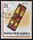 A stamp printed in Papua shows Telefomin shield — Stock Photo