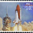 Stamp printed in USA shows launch of Space Shuttle Endeavour - Stock Photo