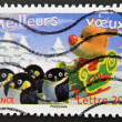 Stamp printed in France shows deer with penguins — Stock Photo