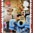 Stamp printed in Great Britain shows image of Gromit&amp;#039;s Christmas pullover - Stock Photo