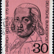 Постер, плакат: A stamp printed in Germany shows Friedrich Holderlin lyric poet