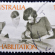 A stamp printed in Australia shows Amputee Assembling Electrical Circuit, Rehabilitation of the Handicapped — Stock Photo