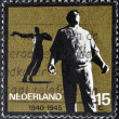 "Stock Photo: Stamp printed in Holland from ""Resistance Commemoration"" issue shows Docker (Amsterdam) and Killed in Action (Waalwijk)"