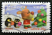 A stamp printed in France shows deer and penguins in the Christmas tree — Stock Photo