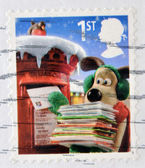 Stamp printed in Great Britain shows image of Gromit posting Christmas cards — Stock Photo