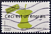 A stamp printed in France dedicated to sustainable ideas, shows core of apple, This is a fertilizer — Stock Photo