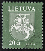A stamp printed in Lithuania shows the national emblem — Stock Photo