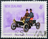 A stamp printed in New Zealanddedicated to Thirteenth International Vintage Car Rally shows Oldsmobile — Stock Photo