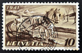 A stamp printed in Switzerland shows Farmer Plowing — Stockfoto