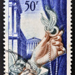 Stock Photo: Jewelry commemorative stamp printed in France shows wealthy woman's hand