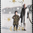 Foto Stock: Christmas stamp printed in Holland shows womand girl