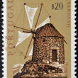 A stamp printed in Portugal shows Serrano windmill — Stock Photo