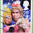 A christmas stamp printed in Great Britain shows The Ugly Sisters from Cinderella — Stok fotoğraf