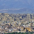 Stock Photo: Partial view of Guadix with cathedral, fortress and cave houses, Granada