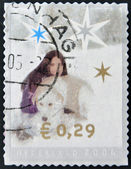 A christmas stamp printed in Holland shows Girl and dog — Stock Photo
