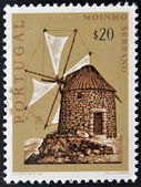 A stamp printed in Portugal shows Serrano windmill — Foto Stock
