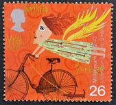 A stamp printed in Great Britain shows Liberation by bike — Stock Photo
