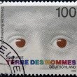 "Stock Photo: Stamp printed in Germany dedicated to international federation ""terre des hommes"" shows eyes of child"