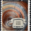 Stock Photo: Stamp printed in Belgium celebrating inauguration of Automatic Telephone Service